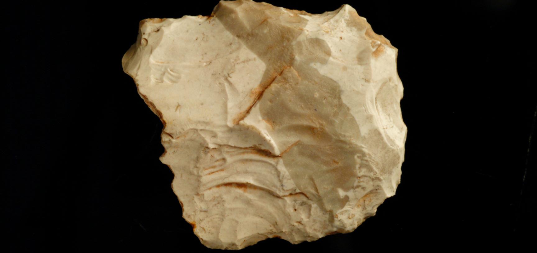 Upper Palaeolithic flint flake.