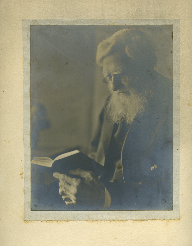 alfred russel wallace photo with book