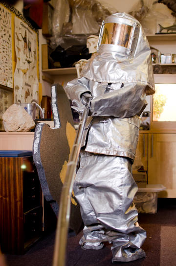 Person in a shiny silver volcanologist suit